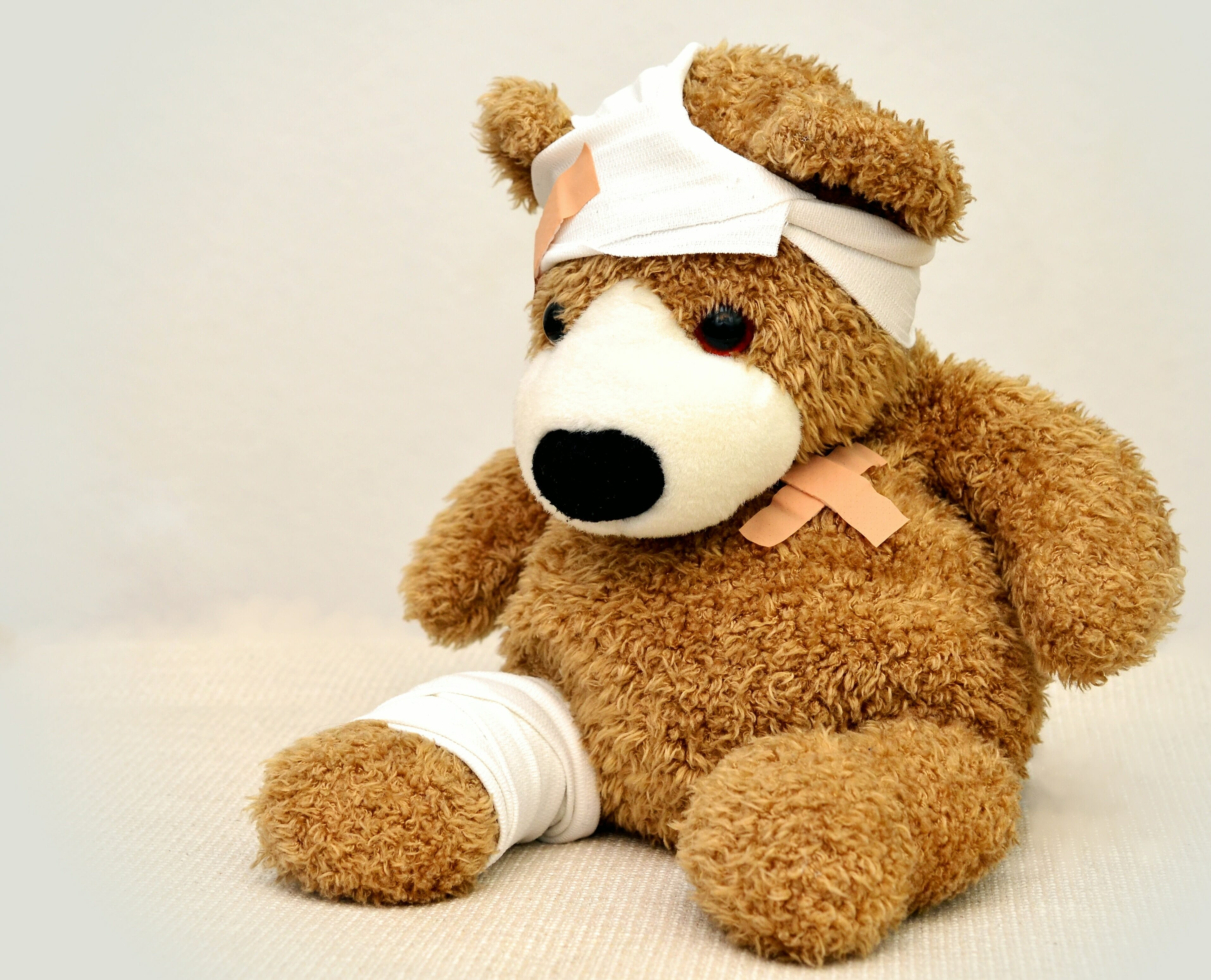 Teddy Bear with bandages on head and leg